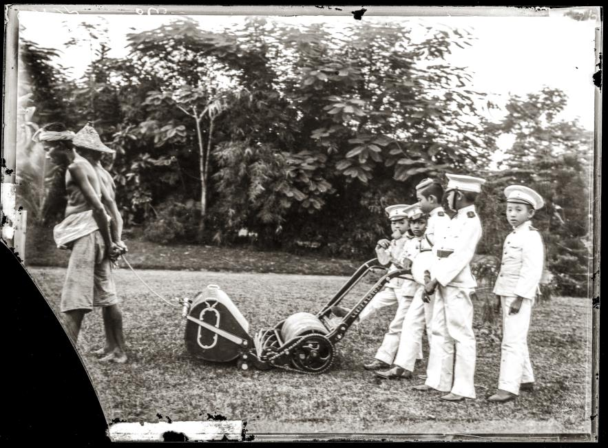 Sons of King Chulalongkorn and other minor princes playing with a lawn mower