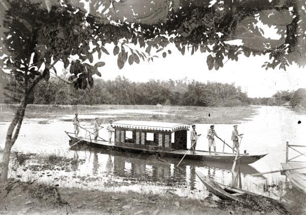 A six-paddle boat with a cabin at the center