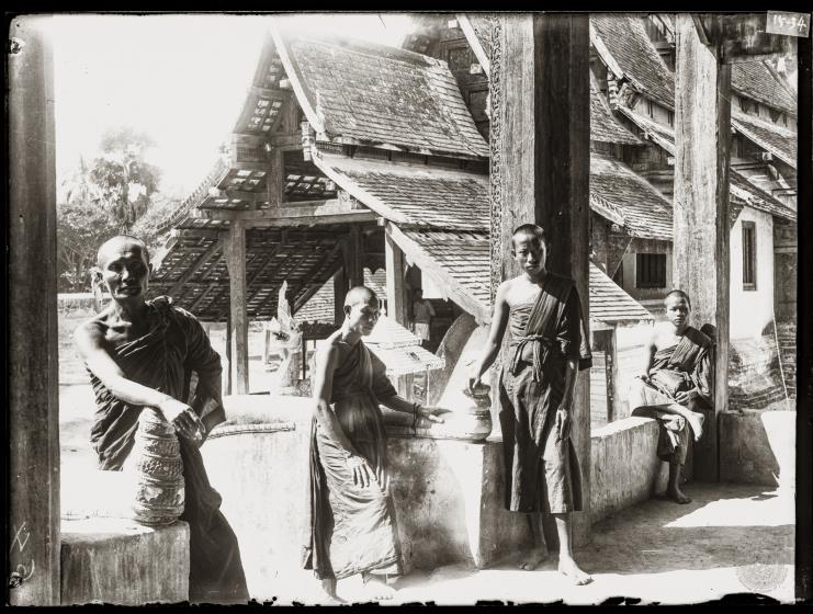 Buddhist monks inside the front porch of the Ordination Hall.